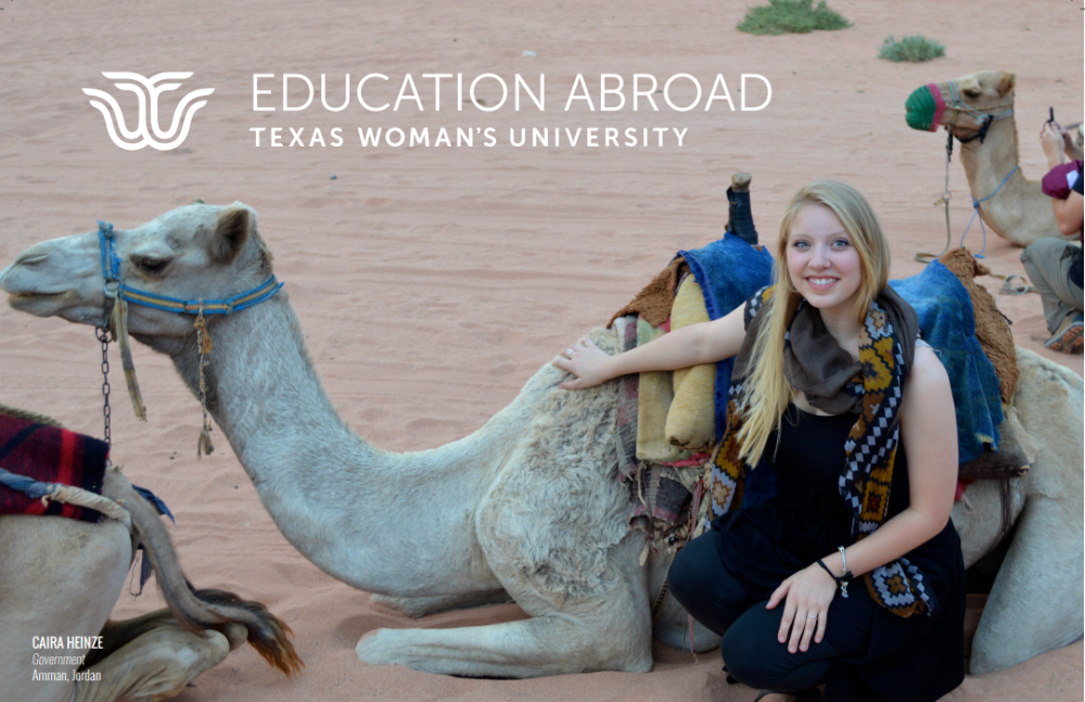 Student sits with camel